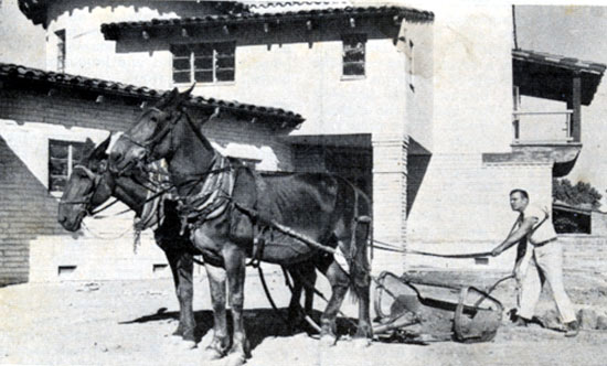 Buck Jones breaks ground for a garden at his San Fernando Valley estate some time in the '30s.