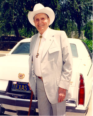 One of the last photos taken of Gene Autry before his death at 91 on October 2, 1998. Gene is standing in front of Monte Hale's Cadillac. (Photo courtesy Neil Summers.)