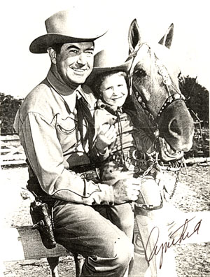 A young Cynthia Hale with her dad, Johnny Mack Brown, and his horse Rebel.