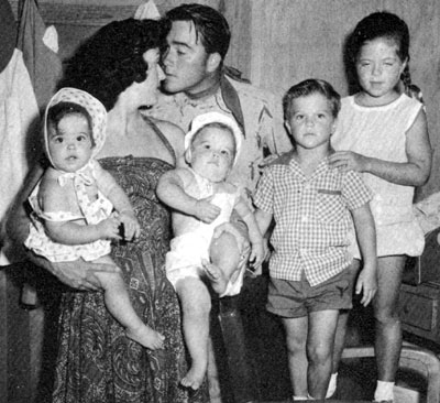 "Dick Jones (""Range Rider"") and family circa 1958. Dick's wife Betty holds the twins, Jennafer and Jeffrey, as Dick looks for a kiss. Beside them are Rick and Melody."
