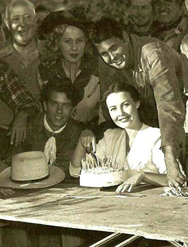 A birthday party for Sunset Carson's wife sometime in 1948-'49 while Sunset was making his low budget series for Yucca Pictures. Sunset's kid brother, Dale Harrison, is on the left, above him is leading lady Pat Starling. (Thanx to Bobby Copeland.)