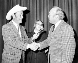 Roy shakes hands with Salisbury, NC, mayor Bill Stanback as Roy received the key to the city at the Terrace Theater in 1975.