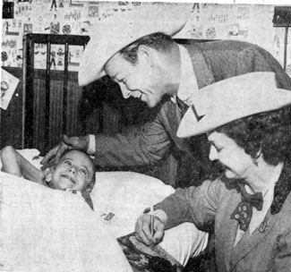 While appearing at the Mid-South Fair in Memphis, TN, in Oct. 1959, Roy and Dale brought a big smile to the face of 9 year old Ralph Dobbins, a patient at St. Joseph Hospital.