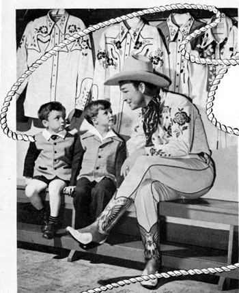 Roy Rogers poses with two young boys for a publicity picture in the mid-'40s at Bloomingdale's in New York.