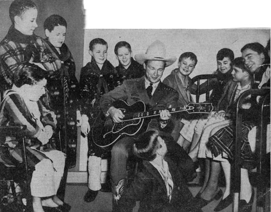 Roy Rogers entertains child heart patients at La Rabida Sanitarium in Chicago in 1944.