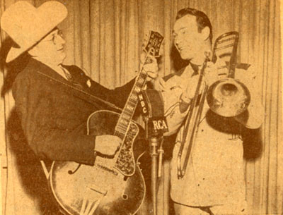 Roy swaps instruments with Tommy Dorsey during an NBC radio show in 1946.