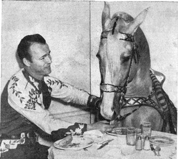 Roy feeds Trigger in this gag photo from the mid-'40s.