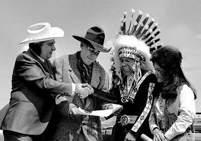 Cartoonist Max Harrison presents a Kentucy Colonel certificate to Ken Maynard and Wild Bill Cody as Cody's wife Genevieve Stockhauser looks on.