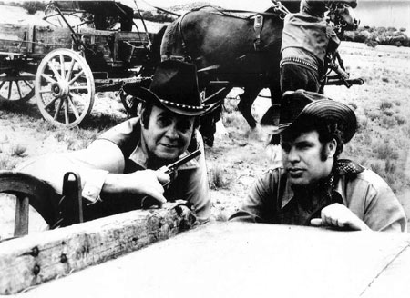 "Sunset Carson and Jerry Whittington in action for ""Marshal of Windy Hollow"". (Lee Hysinger in the background.)"