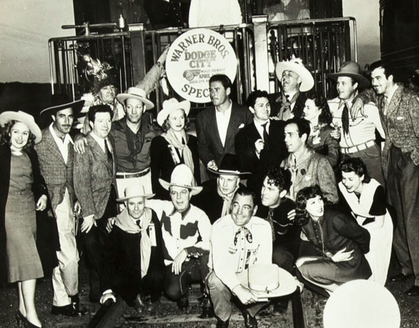 "Warner Bros.' gang at the premiere of ""Dodge City"" in 1939. Group includes Errol Flynn in the center, Gilbert Roland, Maxie Rosenbloom, Hoot Gibson, Buck Jones, Big Boy Williams, Humphrey Bogart, Frank McHugh, Wayne Morris, Priscilla Lane, John Payne, John Garfield, Jim Thorpe, Jean Parker and others.. (Thanx to Jerry Whittington.)"