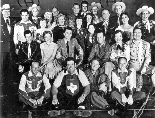 "The cast of TV's ""Town Hall Party"" aka ""Ranch Party"". (Top row L-R): Tex Ritter, Jim Pruitt, Merle Travis, Fiddlin' Kate, Buddy Dooly, Wesley Tuttle, Roy Klein, Joe Maphis, Johnny Bond. (Second row L-R): Shirley Adams, Marilyn Tuttle, Laurie Collins, Tommy Collins, Rose Maphis, Jay Steward, Mary Jane Johnson, Tex Harmon. (Third row L-R): Freddie Hart, Mary Lou Brunell, Bobby Charles, Skeets McDonald, Marion Hall. (Fourth row L-R): Billy Hill, Texas Tiny, Turnip Snodgrass, Pee Wee Adams. (Thanx to Dave Owens.)"