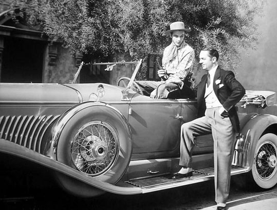 Cars of the Stars: William Powell admires Gary Cooper's Duesenberg. (Thanx to Jerry Baumann.)