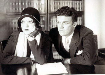"Hollywood's ""IT"" girl, Clara Bow and husband Rex Bell listen intently to court proceedings in the Daisy De Voe grand theft trial in January 1931. De Voe, former secretary of Bow, demanded $125,000 from Bow's attorney for ""Things I know"" according to an asserted confession of De Voe. (Thanx to Bobby Copeland.)"