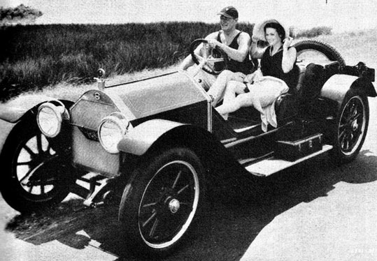 Cars of the Stars: John Wayne takes Maureen O'Hara for a spin in a 1914 Stutz Bearcat. (Thanx to Jerry Baumann.)