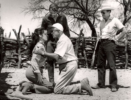 "Director George Marshall shows Audie Murphy just how he should grab Kathryn Grant for a scene in Columbia's ""Guns of Fort Petticoat"" ('57) on location in Tucson, AZ."