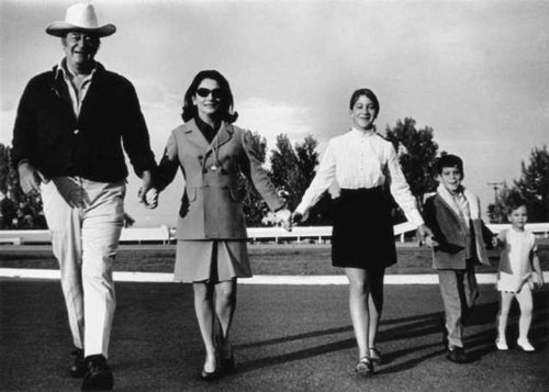 John Wayne with wife Pilar and children, Aissa, Ethan and Marisa in the late '60s.