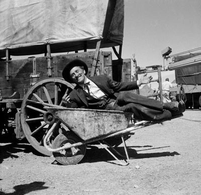 "Kirk Douglas clowns around between takes of ""Gunfight at the OK Corral"" ('57 Paramount). (Thanx to Pat Shields.)"