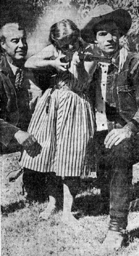 "Eleven year old Marilyn Kington of Rockville, CT, received an A+ on her class assignment about Arizona, then got to visit the set of ""26 Men"" in Scottsdale, AZ. Tris Coffin (left) and Kelo Henderson give marksmanship pointers to Marilyn."