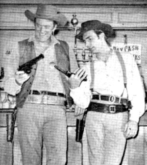 "James Arness as Matt Dillon and Dennis Weaver as Chester Goode laughingly compare guns on ""Gunsmoke""."