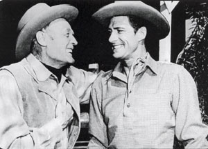 "Forrest Taylor and Jock Mahoney converse during a break in filming from ""Smoky Canyon"" ('52 Columbia)."