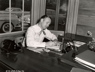 Gene Autry at his home office in 1949. Gene's desk is now a proud possession of Boyd and Donna Magers and WESTERN CLIPPINGS.