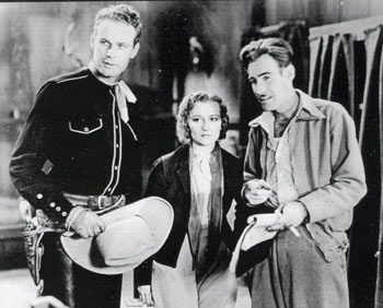 "Lane Chandler and Doris Hill get some direction from Oliver Drake on the set of ""Texas Tornado"" ('32 Kent)."
