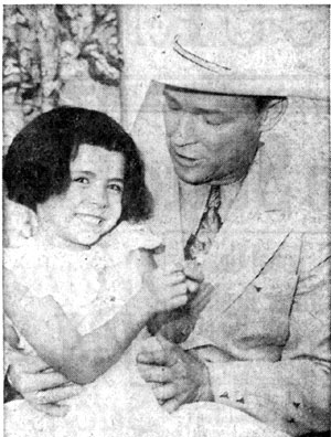 Roy Rogers and four and half year old daughter Debbie at a press conference for the September 1957 New Mexico State Fair in Albuquerque, NM.
