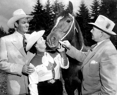 "Allan ""Rocky"" Lane at a racetrack with his mare that had won several races. Alan Young of ""Mr. Ed"" said, ""Everytime Allan got cantankerous with me I would change the conversation and start talking about his racehorse. The little mare had won several races and Allan was always anxious to talk about her."" (Thanx to Bobby Copeland.)"