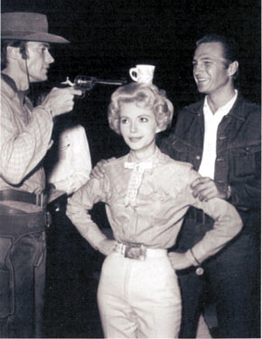 """At this range I can't miss!"", sez Clint Eastwood as he clowns around with Ruta Lee and Eric Fleming on the set of ""Rawhide"". (Thanx to Terry Cutts.)"