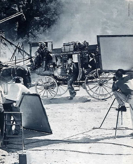 "John Wayne, Claire Trevor and others during the filming of ""Stagecoach"". (Thanx to Bobby Copeland.)"