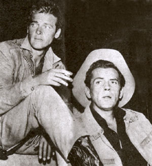 "Cousin Beau Maverick (Roger Moore) and Bart Maverick (Jack Kelly) relax between takes on Warner Bros.' ABC hit ""Maverick"". (Thanx to Terry Cutts.)"
