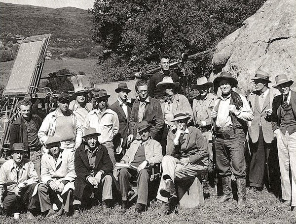 "Look closely and you'll see Bob Livingston, Bob Steele and Max Terhune in this cast and crew photo taken at Iverson Ranch during the making of ""Pals of the Pecos"" ('41 Republic). Director was Les Orlebeck...imagine he's one of the two seated in the front to the right. (Thanx to Jerry Whittington.)"