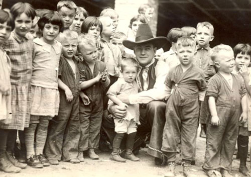 Buck Jones in 1928 visiting St. Joseph's Foundling Home in Scranton, PA. Buck was in Scranton from May 21-23, 1928 performing at the Capitol Theatre. Before leaving the home Buck arranged with the Sisters for an ice cream party for all the children. (Thanx to Jerry Whittington.)