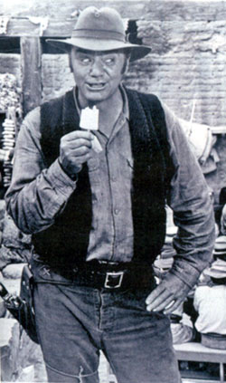 "Ernie Borgnine takes a Popsicle break during the filming of ""The Wild Bunch"" ('69)."