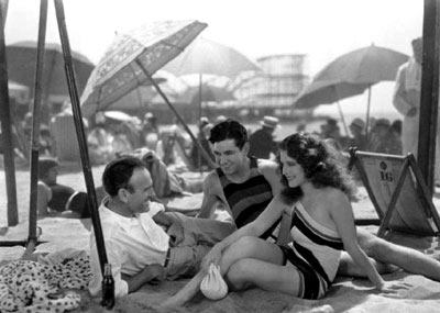 Taking a break at the beach in the '30s are director Sam Wood, Johnny Mack Brown and Norma Shearer. (Thanx to Jerry Whittington.)