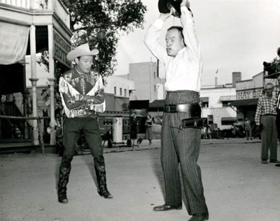 "Roy Rogers admires Bob Hope's trick gun holsters on the set of ""Son of Paleface"" ('52 Paramount). (Thanx to Jerry Whittington.)"