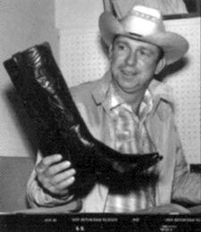 Slim Pickens admires his new Lucchese boots, circa mid-'50s.