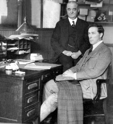 William S. Hart sits with former western lawman Bat Masterson at Masterson's desk at the NEW YORK MORNING TELEGRAPH office on October 7, 1921. Masterson died eighteen days after this photo was taken.