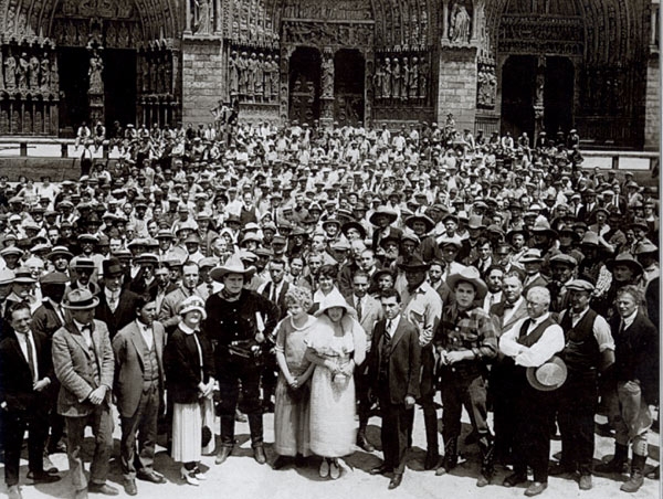 "Promotional photo taken circa 1924 spotlighting Universal's Blue Streak Players, the studio's top boxoffice draws of the day. In the front row you'll notice Jack Hoxie and Hoot Gibson. Can anyone identify any of the other cowboys? The players pose in front of the great doors of the Notre Dame cathedral facade which was used in ""Hunchback of Notre Dame"" and Tom Mix's ""My Pal the King"". (Courtesy Richard Bann.)"
