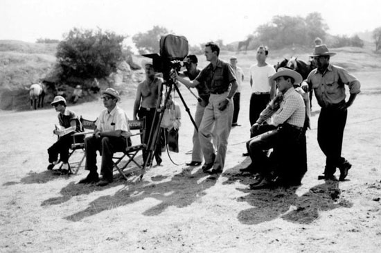 Director Harry Keller, seated in the white shirt, and Rex Allen on location for one of Rex's Republic Pictures. (Thanx to Jerry Whittington.)