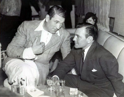 Discussing the business over a couple of drinks in 1936 are Victor McLaglen and Buck Jones. (Thanx to Bobby Copeland.)