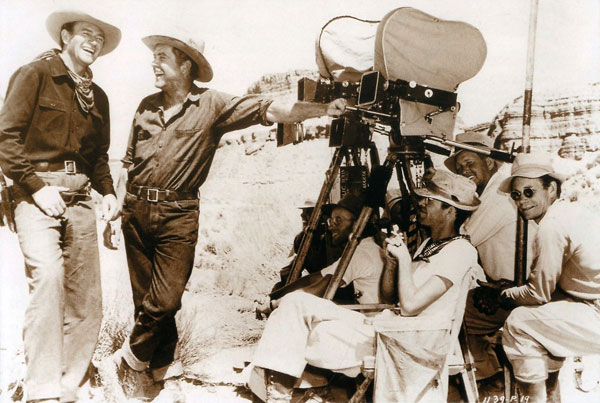 "John Wayne and Grant Withers share a laugh while making ""In Old Oklahoma""  ('43 Republic). (Thanx to Bobby Copeland.)"