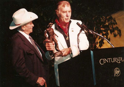 George Montgomery receives an award from Gene Autry during the 4th Autry Museum Gala 11/17/90 at the Century Park Hotel in L.A. (Thanx to Maxine Hansen, Autry Entertainment.)