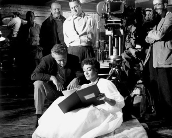 "Joan Crawford goes over a ""Johnny Guitar"" script point with director Nicholas Ray. (Thanx to Jerry Whittington.)"