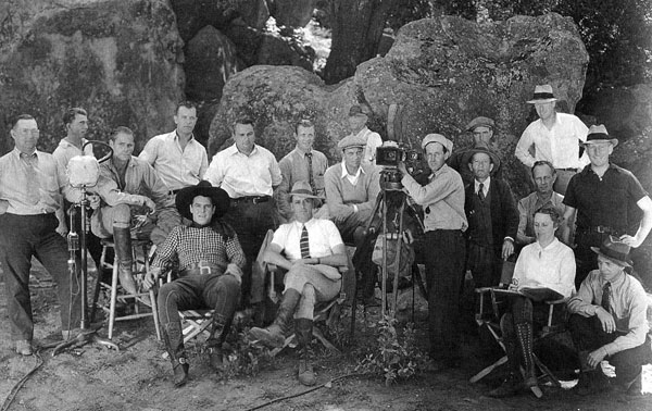 Ken Maynard, director Spencer Gordon Bennet (seated) and their Larry Darmour/Columbia Pictures production crew in 1936. (Thanx to Jerry Whittington.)