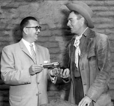 Randolph Scott with Fred Roff Jr., president of Colt's Firearms Manufacturing Co.