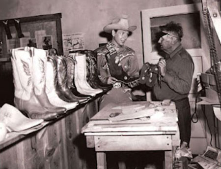Rex Allen with noted Hollywood bootmaker Charlie Garrison. Garrison, who died in 1955, was a well known bootmaker in the San Angelo, TX, area before moving at the close of the '30s to Los Angeles where he became popular for his intricate boots. He soon became associated in business with Roy Rogers, doing special order bootwork for the short lived Roy Rogers Ranger Posts. Garrison went out on his own following the collapse of Rogers' western stores. Garrison later left California and ran a boot shop in Llano, TX. (Photo thanx to Jerry Whittington.)