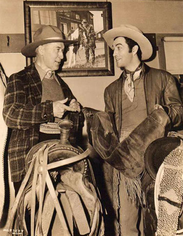 "During the making of MGM's ""Billy the Kid"" in 1941, William S. Hart gives Robert Taylor a little advice about a pair of chaps. (Thanx to Bobby Copeland.)"