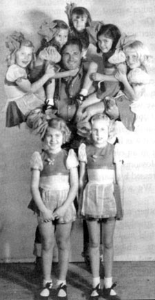 "Ray ""Crash"" Corrigan demonstrates his strength with the Meglin Kiddies while filming The Three Mesquiteers ""Roarin' Lead"" ('36 Republic)."