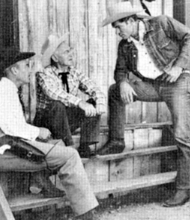"Tris Coffin and Kelo Henderson chat with John Redmond between scenes of ""26 Men"". Redmond was one of the original members of the Arizona Rangers on which the TV series was based."